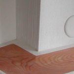 particolare stufa a legna con foglio di legno