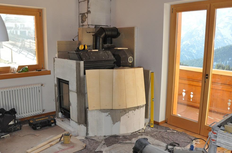 stufa a legna con sistema caldaia Brunner rivestimento